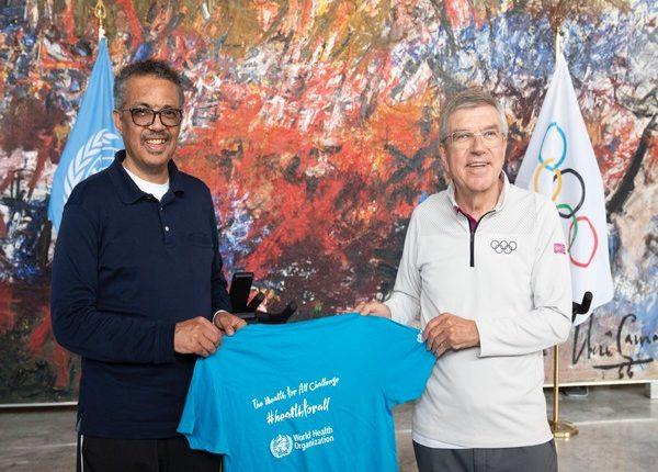 Tedros Adhanom Ghebreyesus (L) and Thomas Bach (R) (Photo/WHO Twitter)